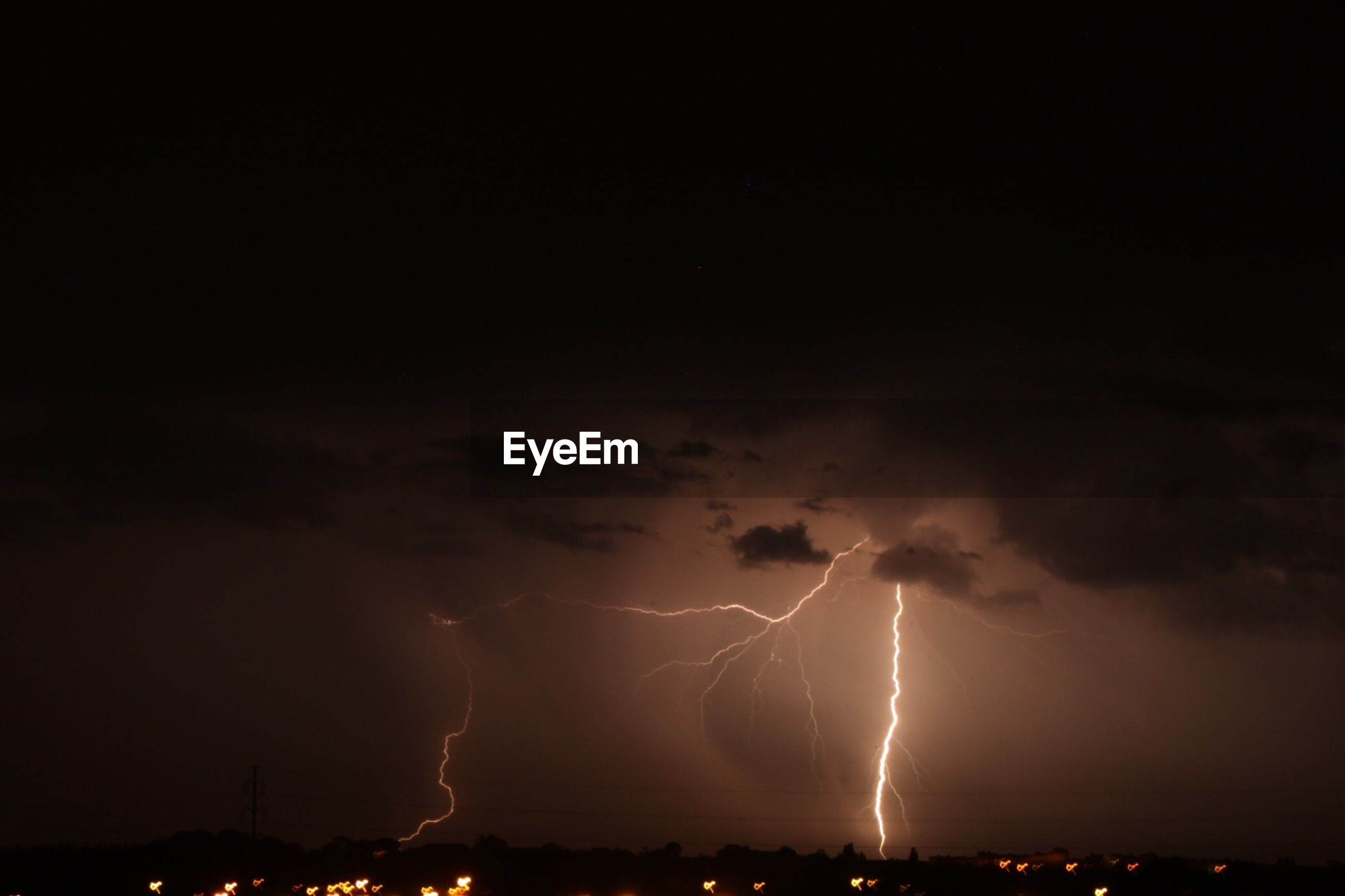 Forked lightning in sky at night