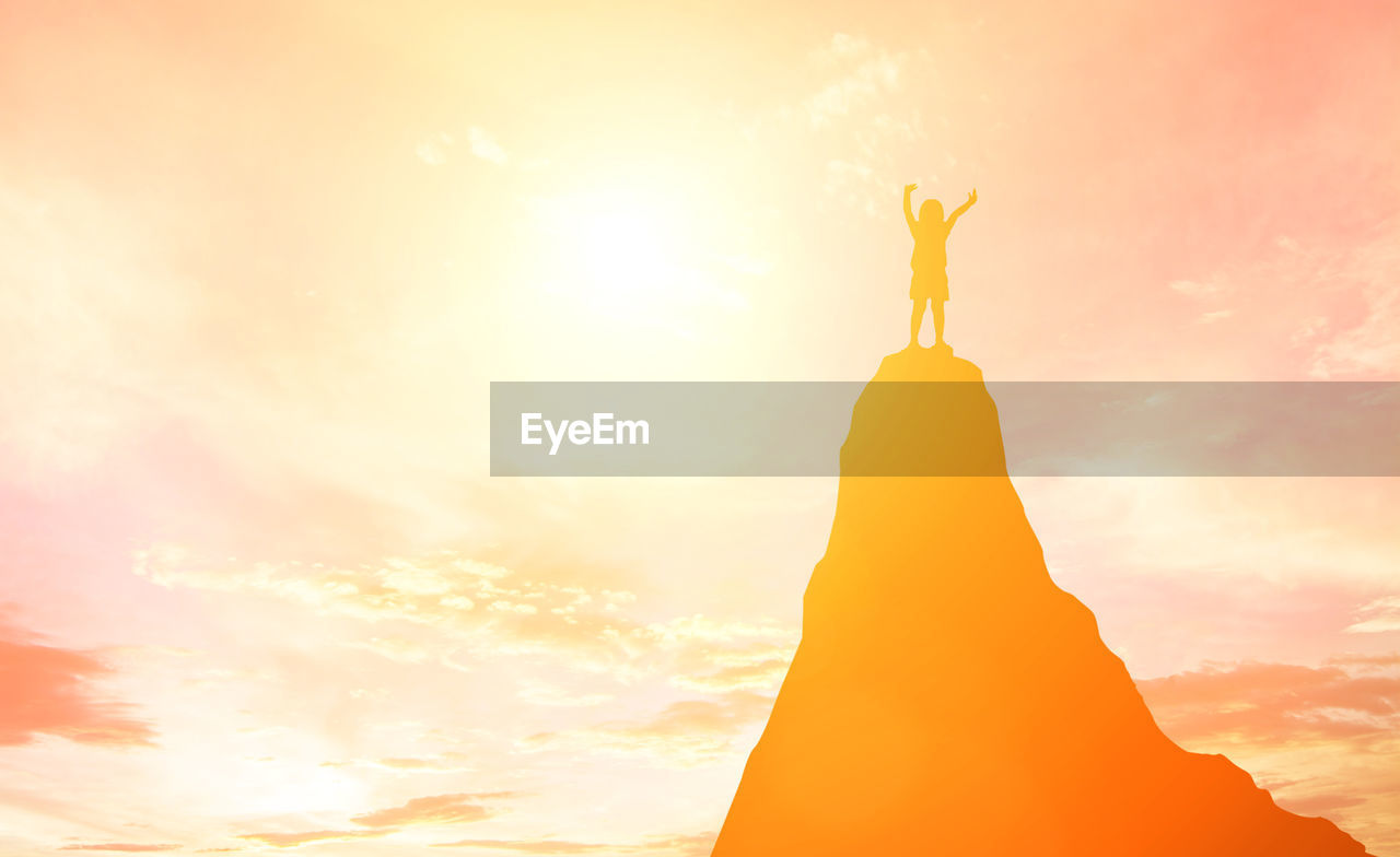 sky, sunset, representation, human representation, statue, low angle view, orange color, silhouette, sculpture, nature, art and craft, no people, standing, beauty in nature, sunlight, cloud - sky, outdoors, creativity, yellow, religion