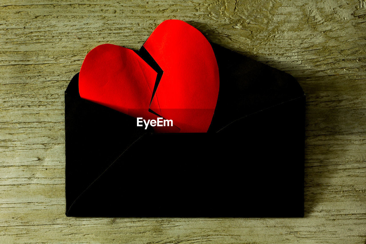 red, positive emotion, table, still life, love, heart shape, emotion, indoors, wood - material, directly above, high angle view, no people, close-up, art and craft, paper, craft, creativity, design, shape