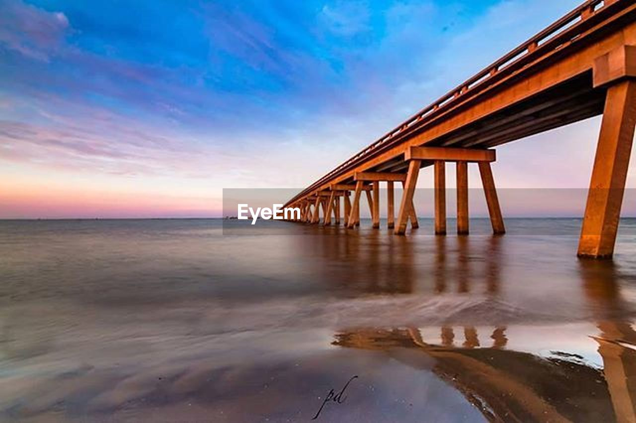 sea, beach, sunset, cloud - sky, sky, water, reflection, horizon over water, outdoors, bridge - man made structure, nature, sand, blue, summer, scenics, no people, built structure, landscape, tranquility, vacations, beauty in nature, architecture, day