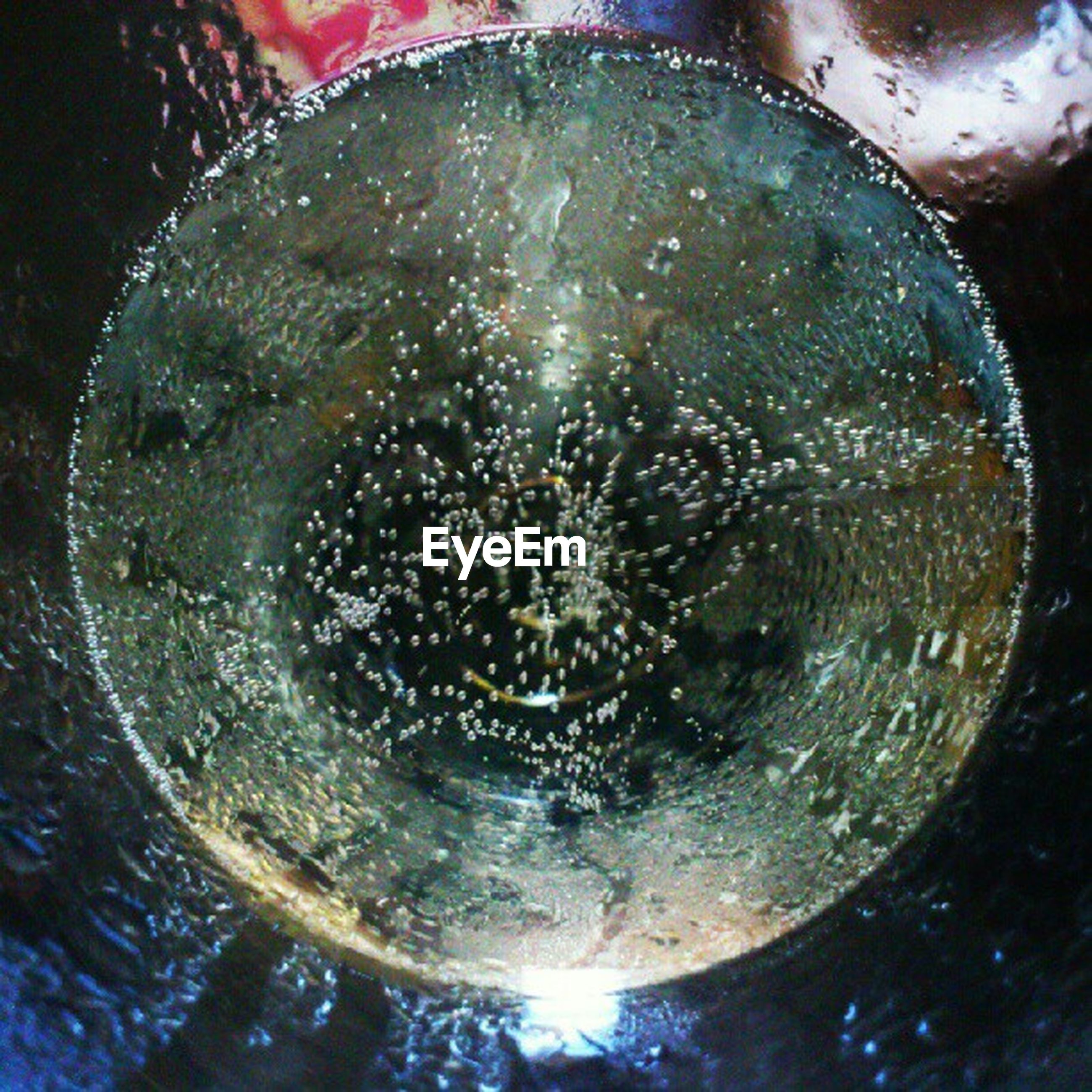 water, drop, circle, close-up, indoors, wet, glass - material, full frame, transparent, bubble, backgrounds, reflection, refreshment, purity, geometric shape, rippled, splashing, high angle view, pattern, drink