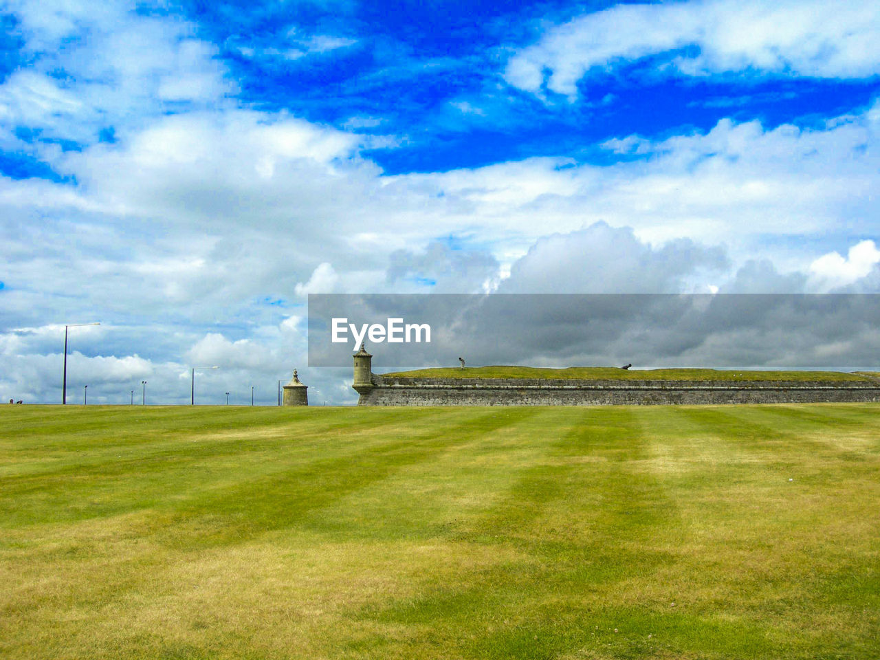sky, grass, cloud - sky, nature, environment, no people, land, plant, field, day, built structure, architecture, landscape, green color, scenics - nature, beauty in nature, outdoors, non-urban scene, tranquil scene, tranquility, archaeology