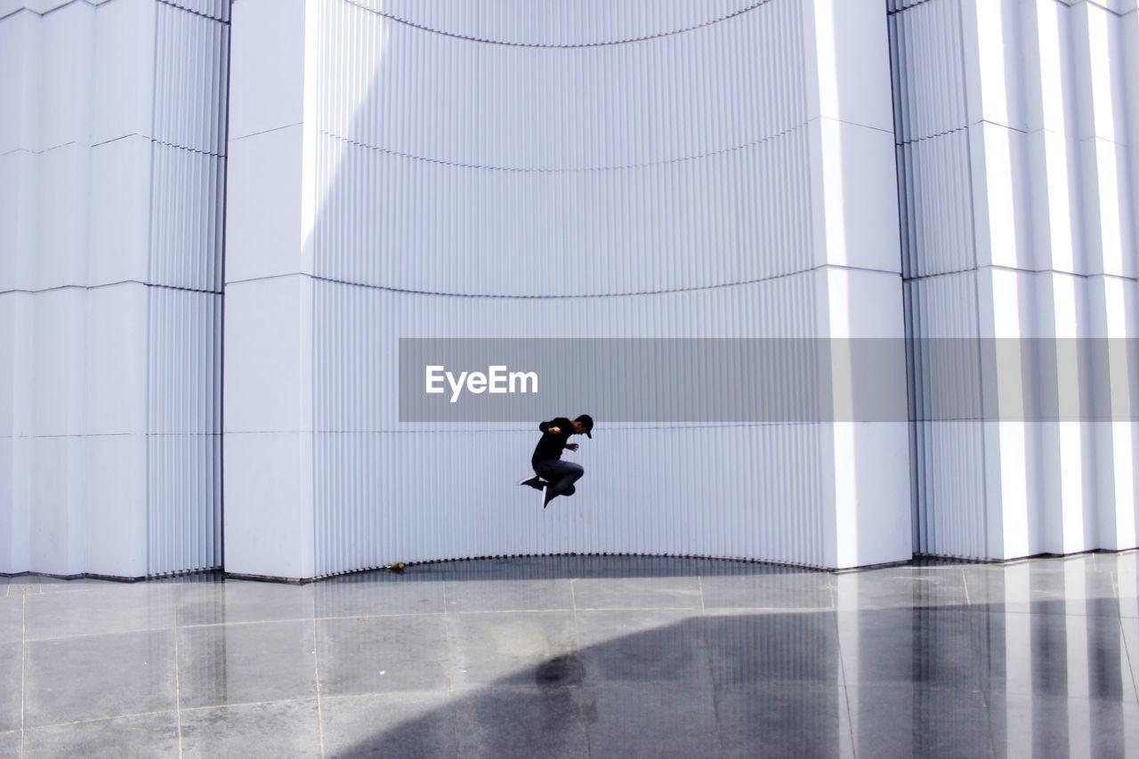 Man jumping in modern building