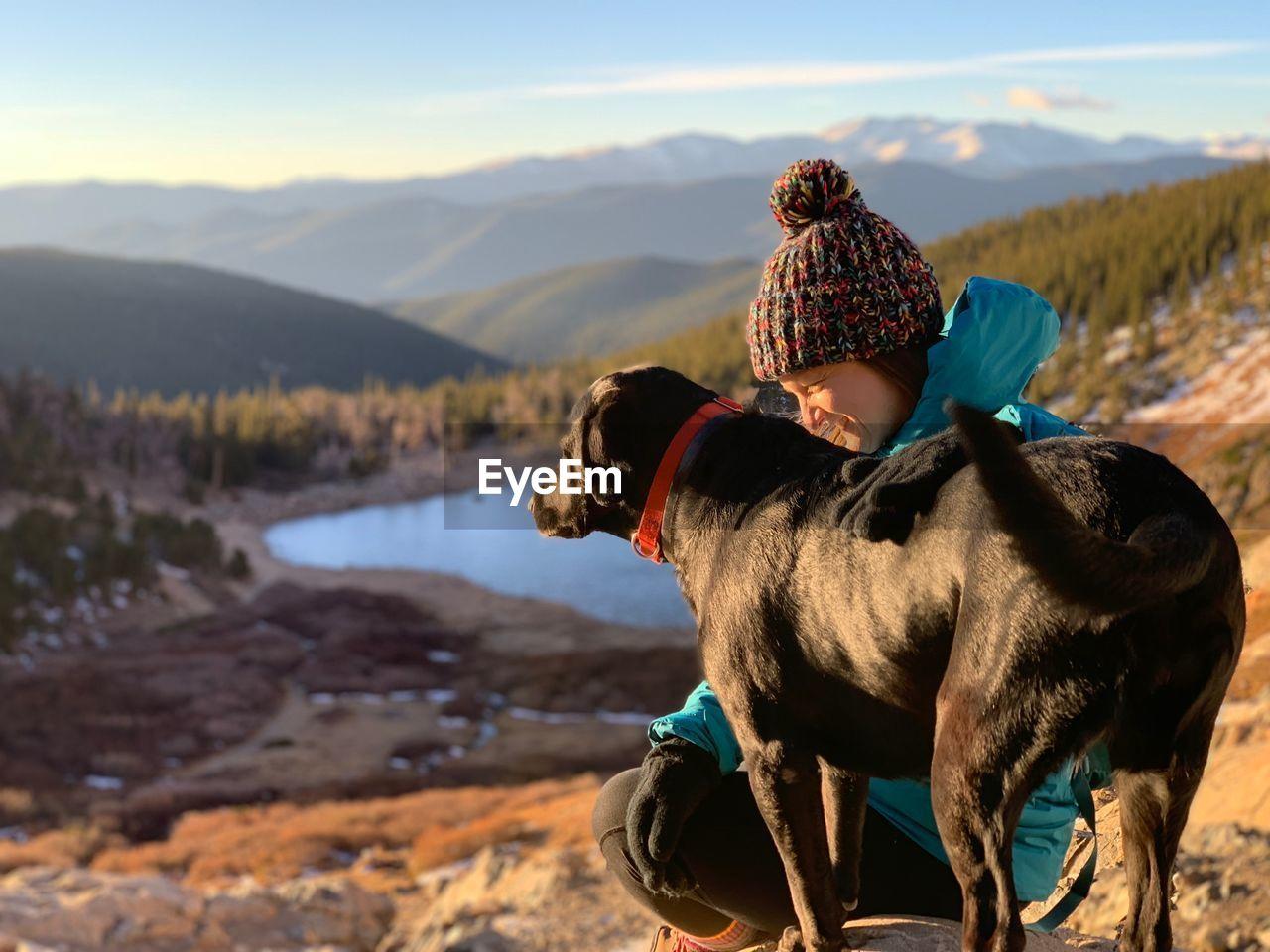 Smiling Woman Petting Dog