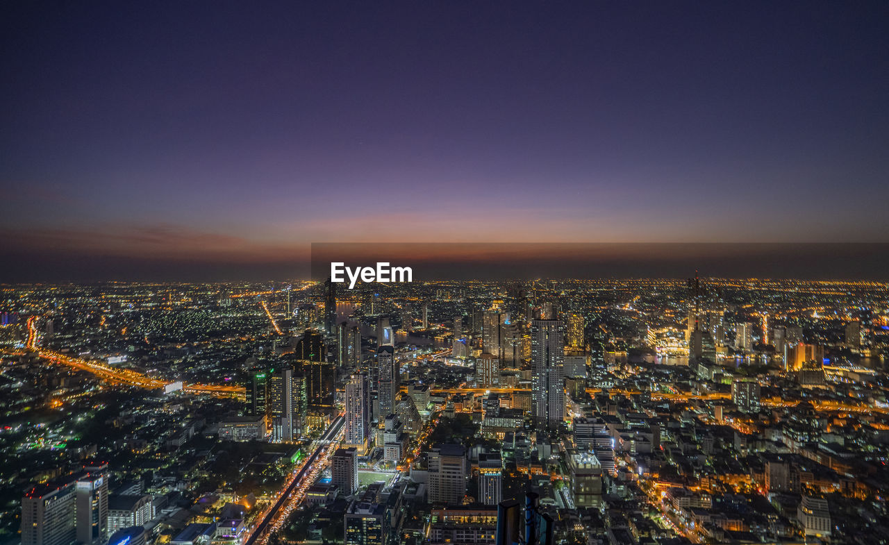 city, building exterior, cityscape, architecture, built structure, sky, crowded, crowd, illuminated, building, high angle view, residential district, nature, copy space, city life, aerial view, night, office building exterior, outdoors, skyscraper, modern