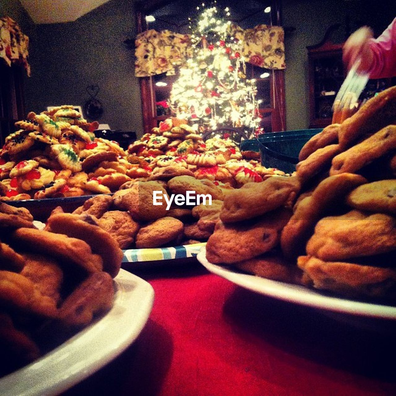 food and drink, food, indoors, freshness, christmas, indulgence, unhealthy eating, celebration, plate, sweet food, large group of objects, temptation, ready-to-eat, no people, dessert, snack, night, illuminated, close-up
