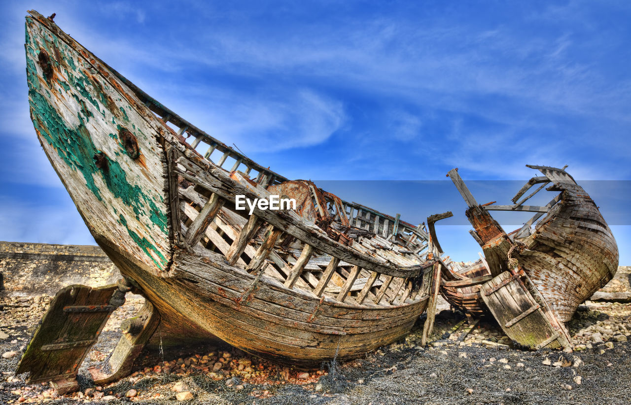 nautical vessel, abandoned, sky, transportation, mode of transportation, ship, shipwreck, run-down, obsolete, deterioration, damaged, decline, day, nature, cloud - sky, sea, bad condition, beach, land, water, no people, outdoors, ruined, fishing boat