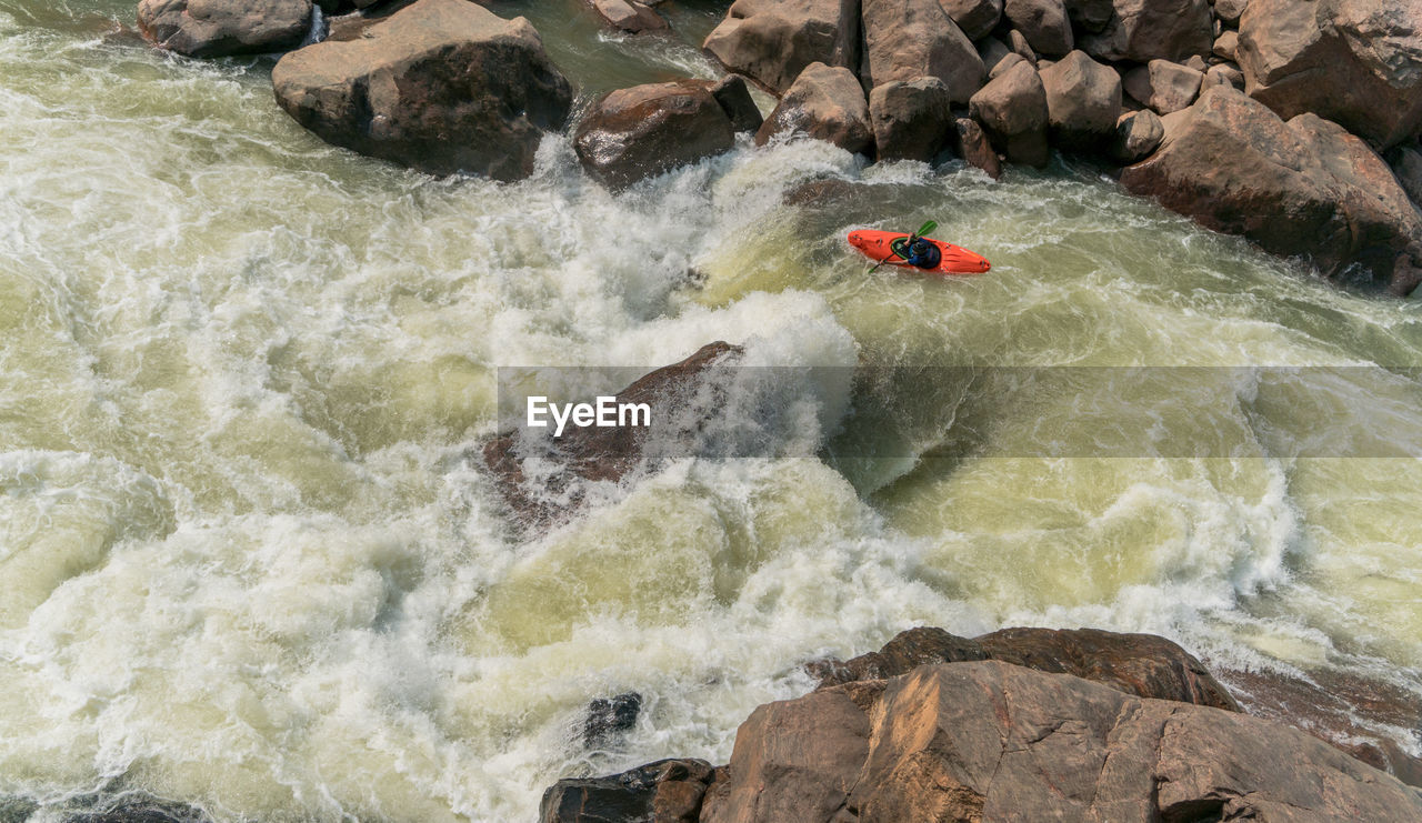 water, sport, adventure, transportation, nautical vessel, motion, rock, river, extreme sports, rock - object, sign, nature, solid, warning sign, speed, people, kayak, challenge, communication