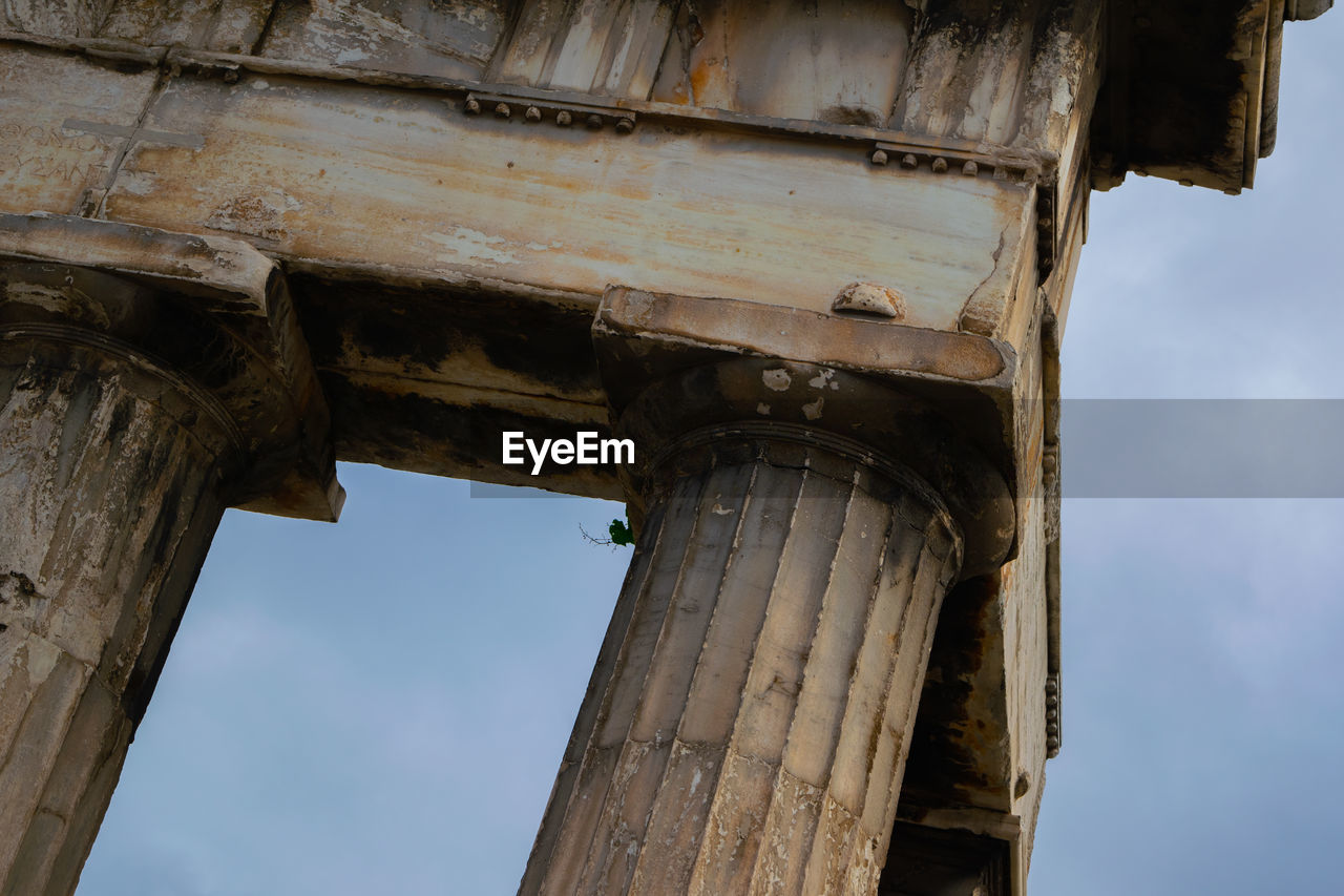 architecture, low angle view, built structure, sky, history, the past, architectural column, no people, old, day, damaged, weathered, old ruin, nature, ancient, wood - material, cloud - sky, obsolete, bad condition, building exterior, outdoors, ruined, ancient civilization, deterioration, archaeology