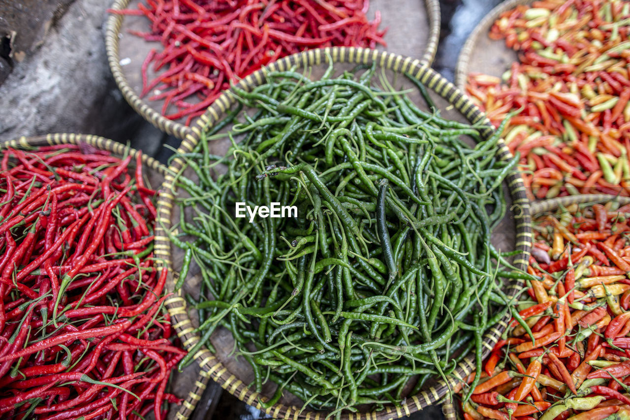 green color, food, food and drink, market, still life, large group of objects, pepper, no people, choice, vegetable, chili pepper, wellbeing, red, for sale, high angle view, freshness, healthy eating, variation, abundance, spice, red chili pepper, sale, retail display