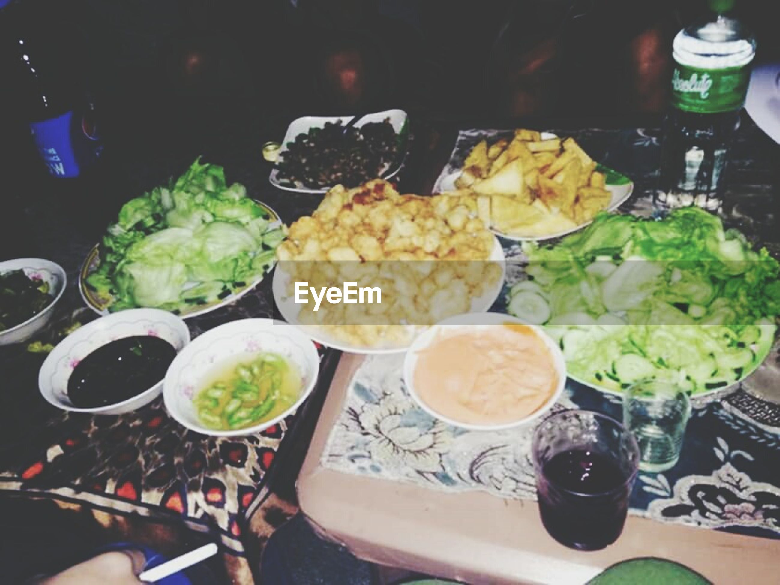 food and drink, food, freshness, indoors, healthy eating, table, ready-to-eat, plate, bowl, meal, vegetable, high angle view, drink, still life, salad, person, serving size, unrecognizable person