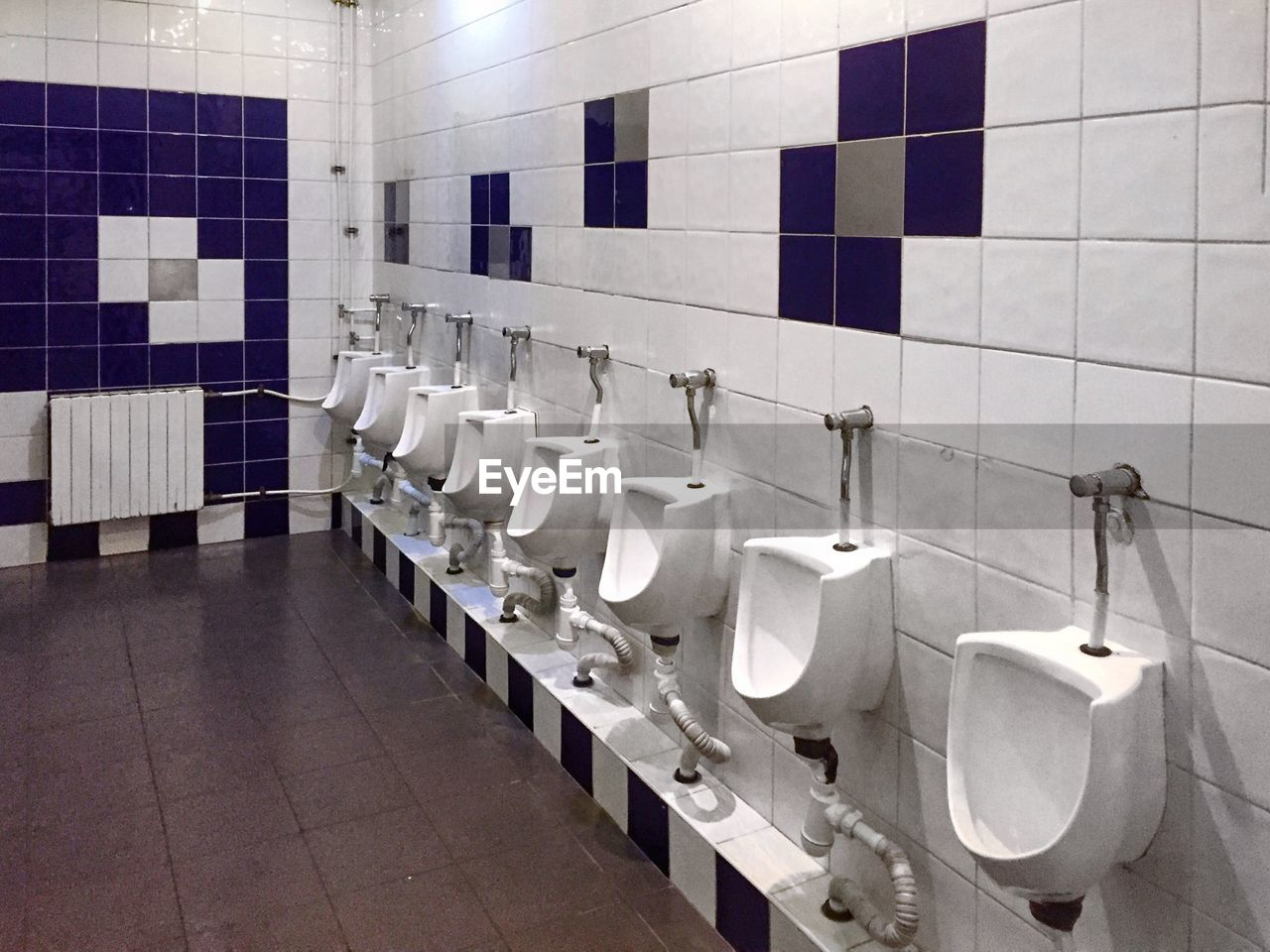 bathroom, tile, toilet, flooring, hygiene, indoors, public restroom, in a row, public building, urinal, white color, wall - building feature, domestic bathroom, tiled floor, absence, no people, repetition, domestic room, seat, convenience, clean