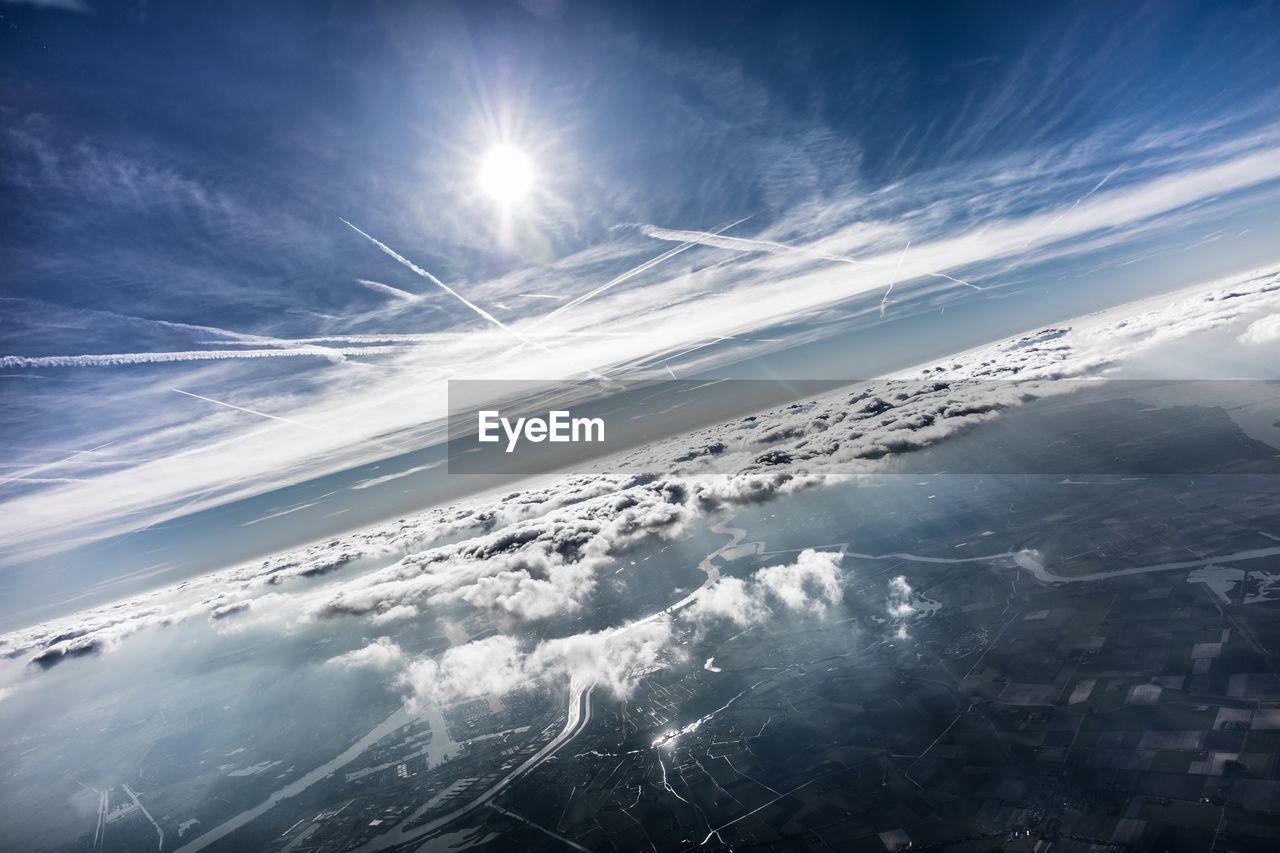 Tilt Shot Of Clouds Over Landscape