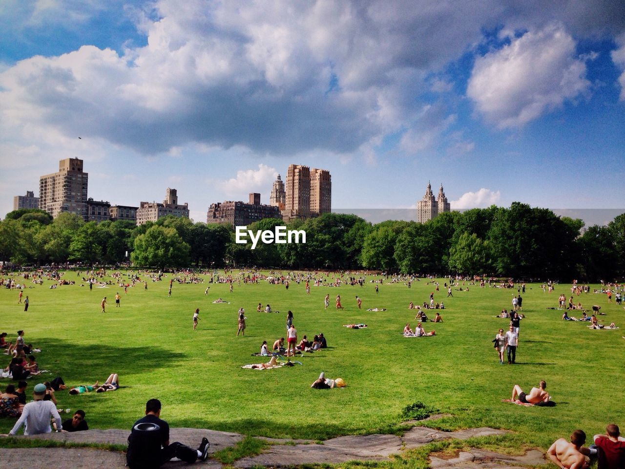 People At Park Against Sky In City