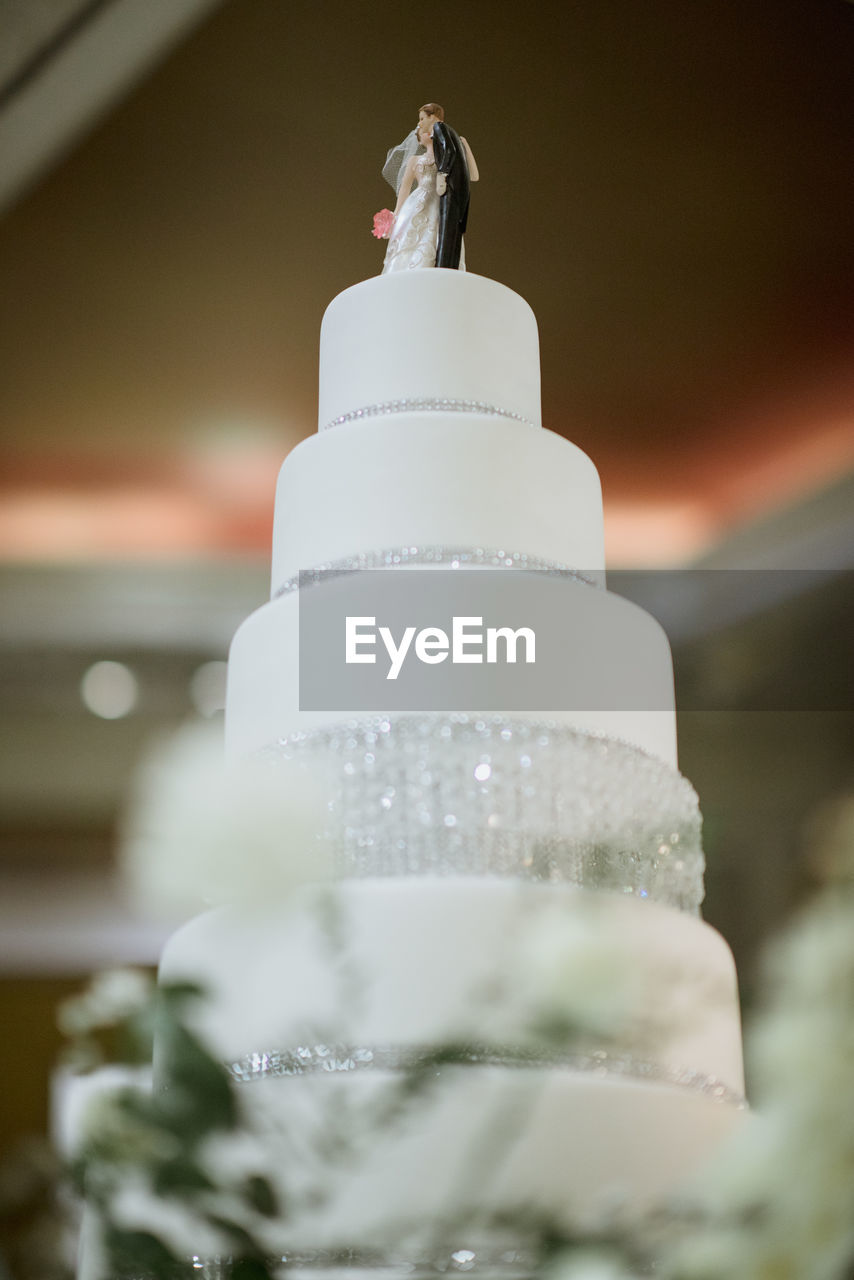 sweet food, celebration, wedding, wedding cake, no people, life events, food and drink, sweet, event, dessert, food, selective focus, close-up, white color, indoors, celebration event, cake, focus on foreground, figurine, human representation, temptation