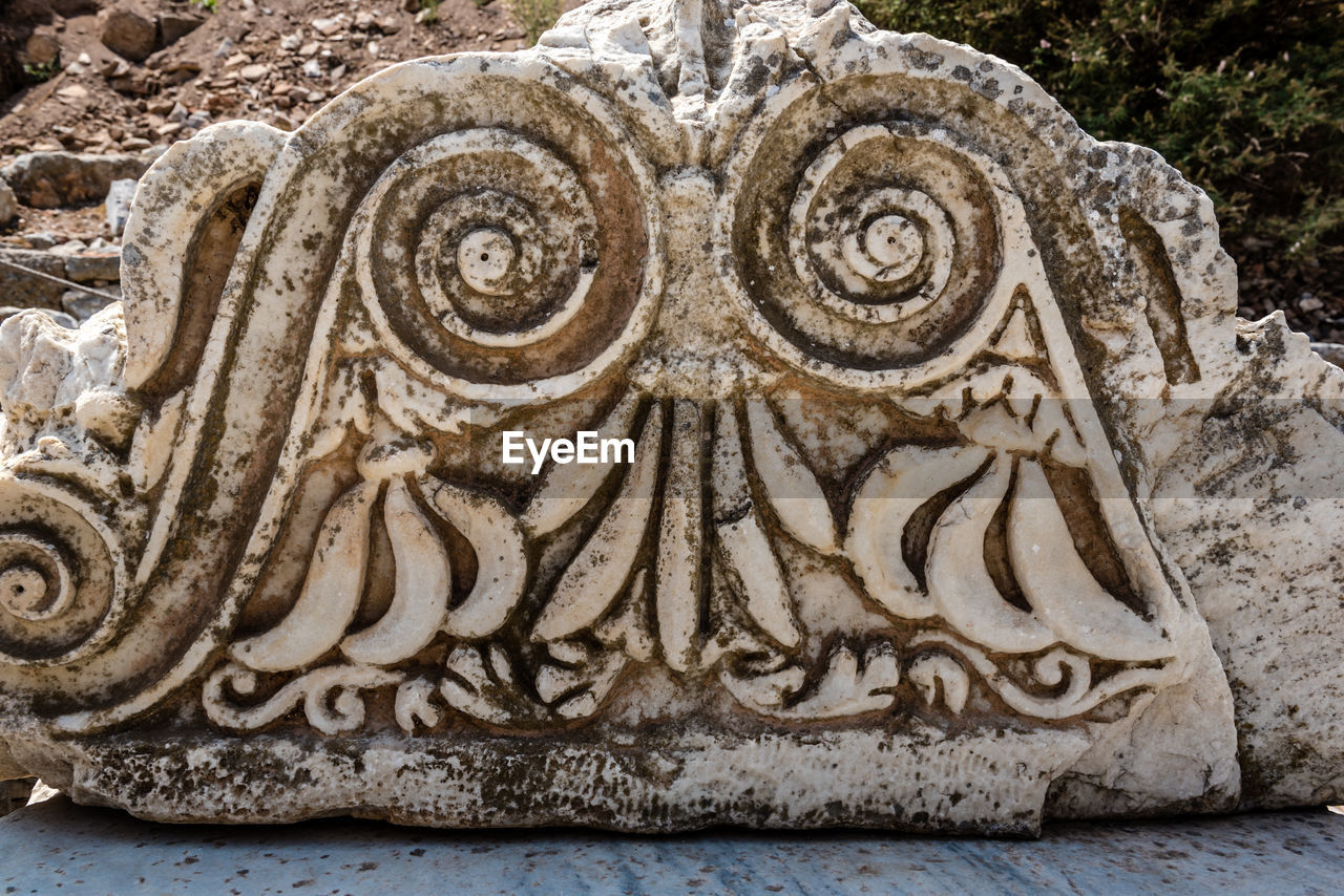 art and craft, close-up, no people, craft, creativity, pattern, solid, carving - craft product, architecture, day, design, floral pattern, representation, sculpture, animal themes, nature, ornate, history, animal, rock, bas relief, carving