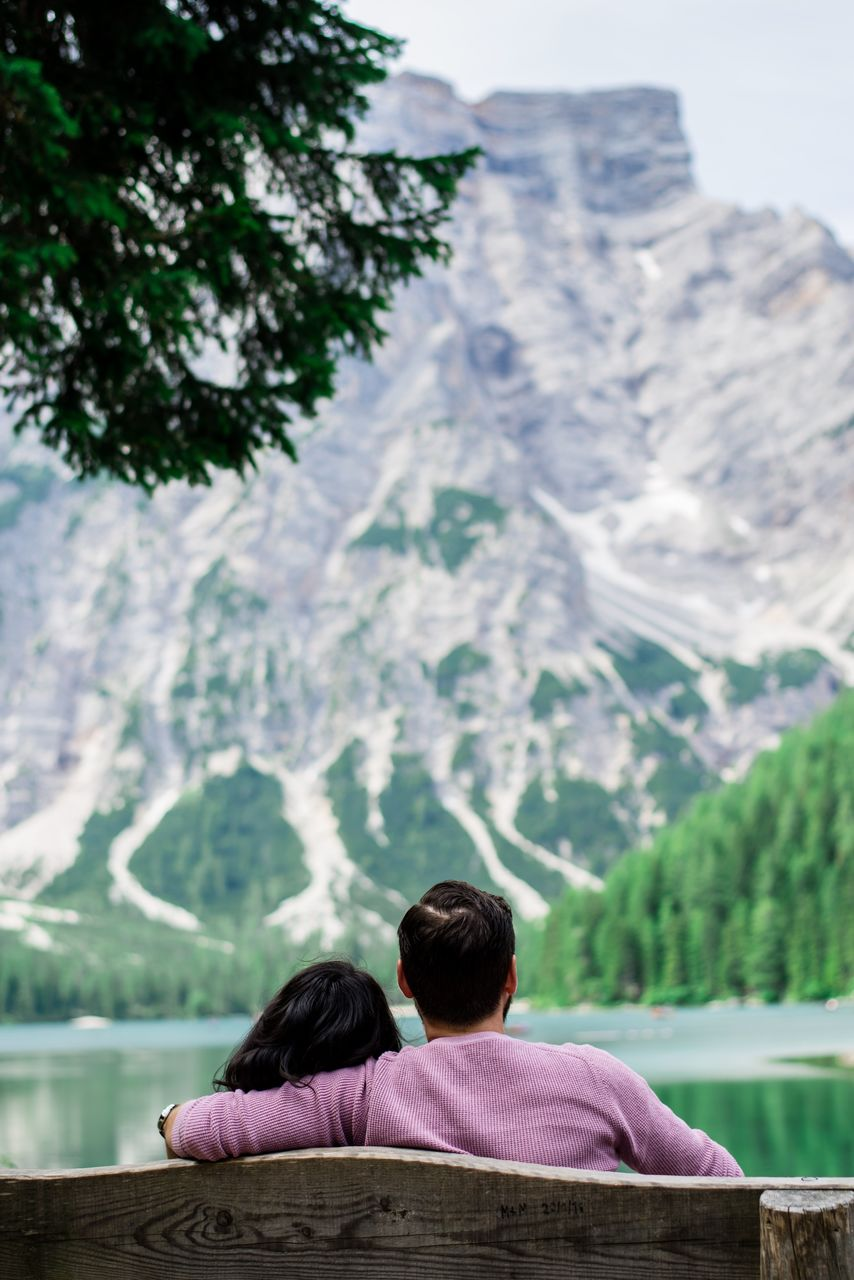 Rear View Of Couple Looking At Mountain