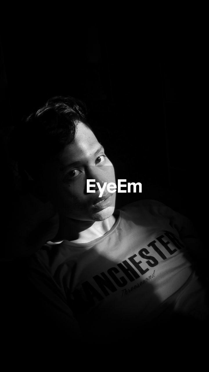 Portrait of boy in darkroom