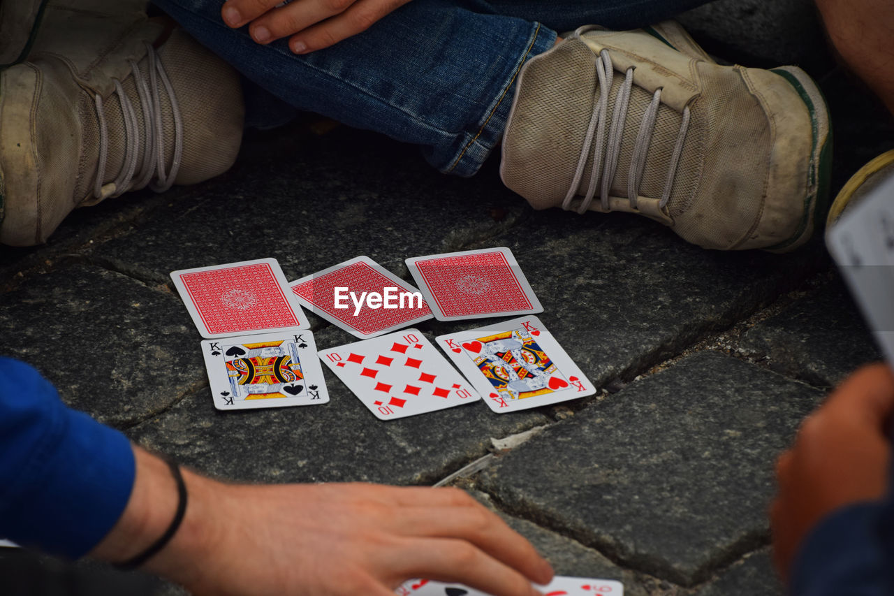 Close-Up Of People Playing Cards