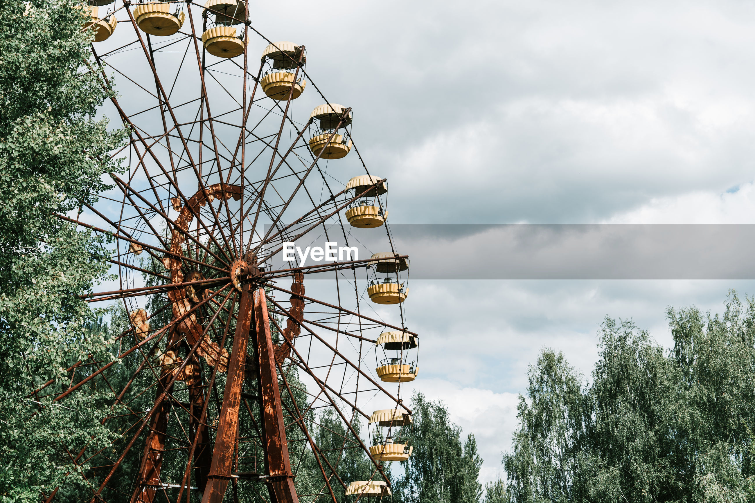 Low angle view of abandoned ferris wheel against sky near chernobyl