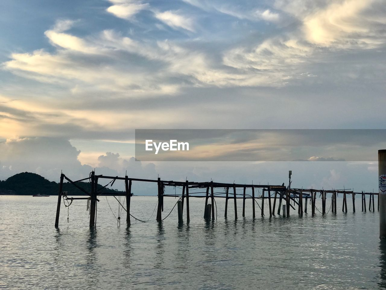 cloud - sky, sky, water, sunset, beauty in nature, scenics - nature, waterfront, tranquil scene, tranquility, nature, architecture, silhouette, built structure, pier, sea, connection, bridge, non-urban scene, no people, bridge - man made structure, outdoors, wooden post