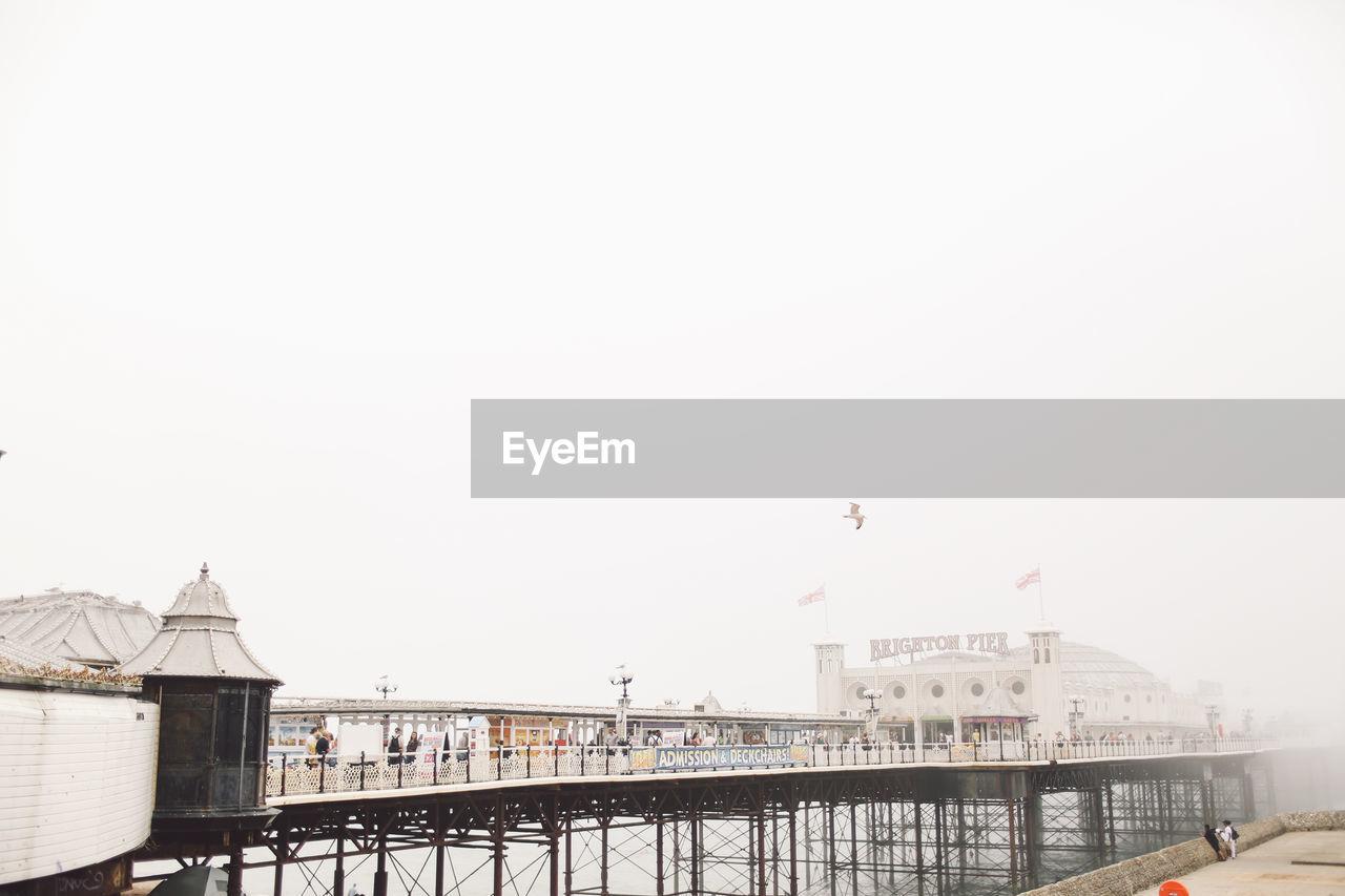 Brighton Pier Over Sea Against Clear Sky