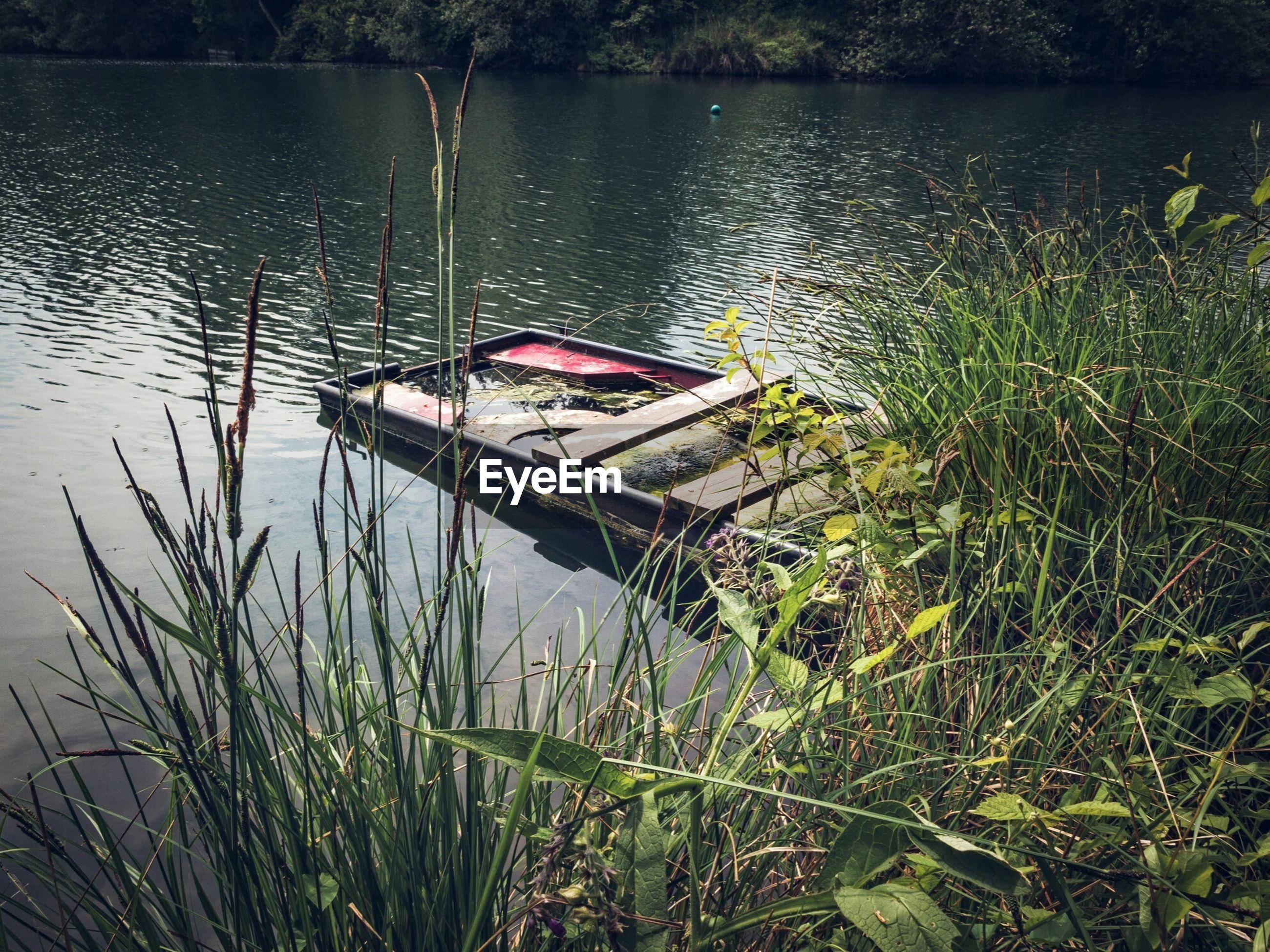 BOAT MOORED AT LAKE