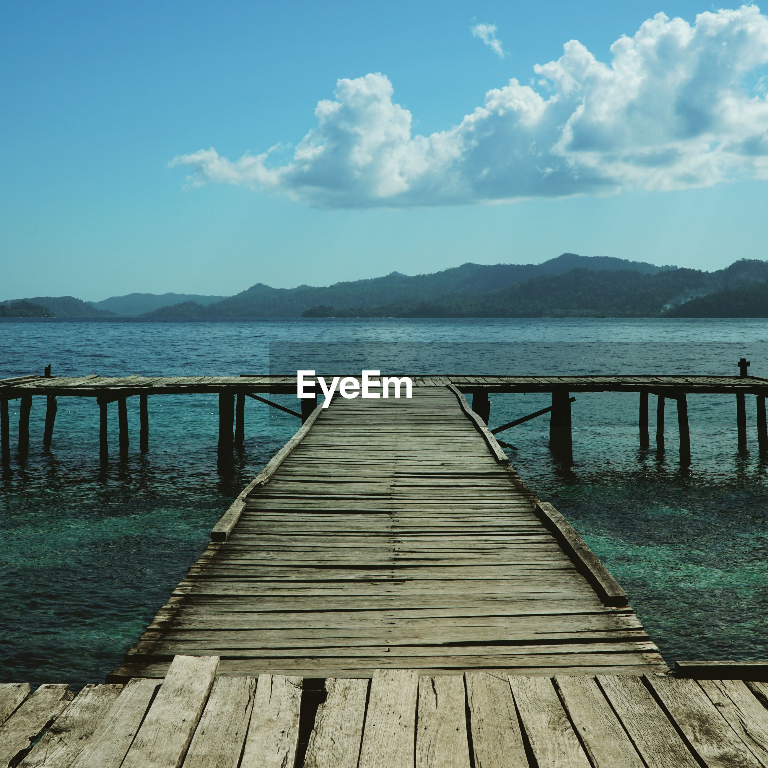 Wooden jetty leading to lake