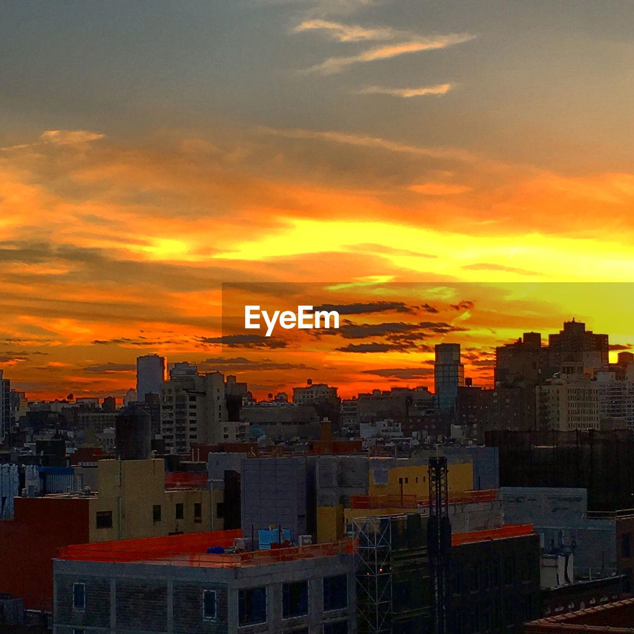 sunset, orange color, architecture, building exterior, cityscape, city, built structure, sky, skyscraper, no people, city life, cloud - sky, outdoors, urban skyline, nature
