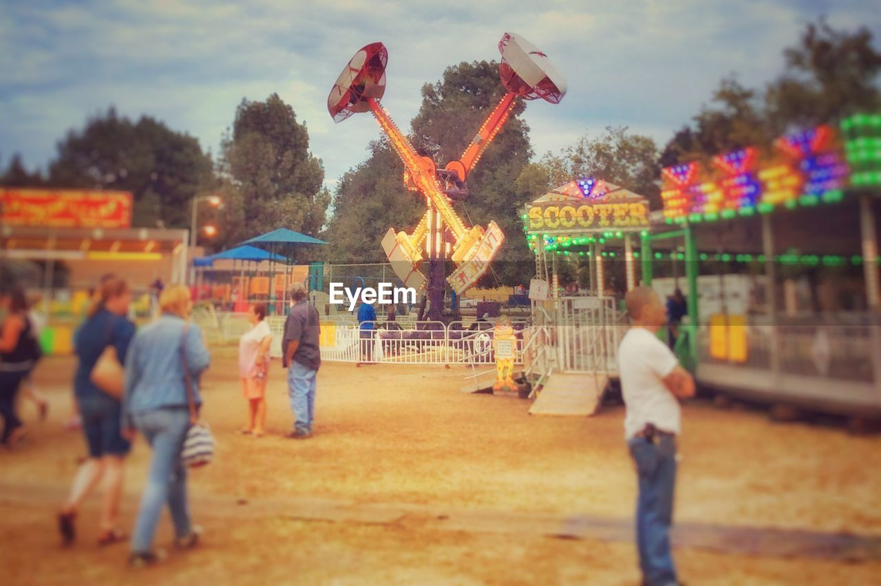 real people, large group of people, leisure activity, men, outdoors, autumn, day, lifestyles, tree, sky, nature, carousel, people