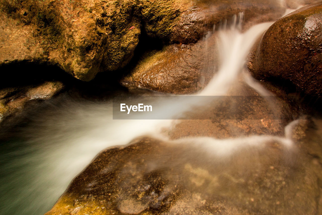 rock, motion, long exposure, blurred motion, scenics - nature, rock - object, solid, no people, nature, waterfall, water, beauty in nature, flowing water, day, flowing, non-urban scene, speed, environment, outdoors, power in nature, falling water