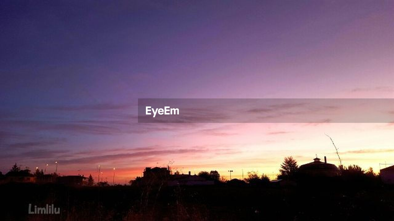 sunset, silhouette, dramatic sky, dusk, sky, tree, cloud - sky, building exterior, city, architecture, no people, built structure, scenics, outdoors, travel destinations, cityscape, multi colored, illuminated, night, nature, urban skyline, beauty in nature