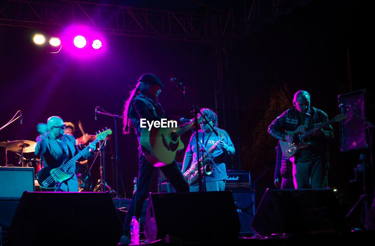 PEOPLE PLAYING AT NIGHT