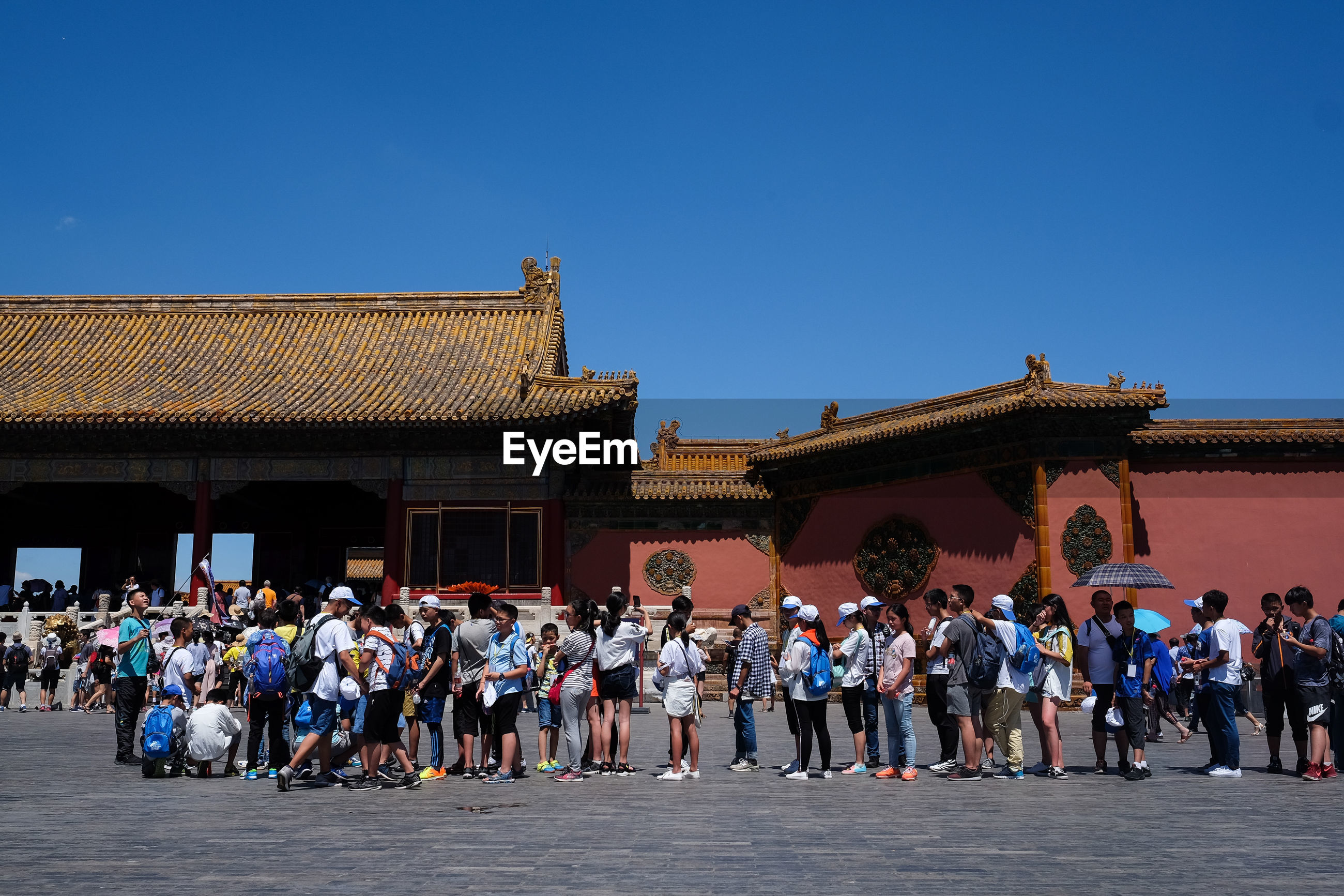 GROUP OF PEOPLE AGAINST BLUE SKY