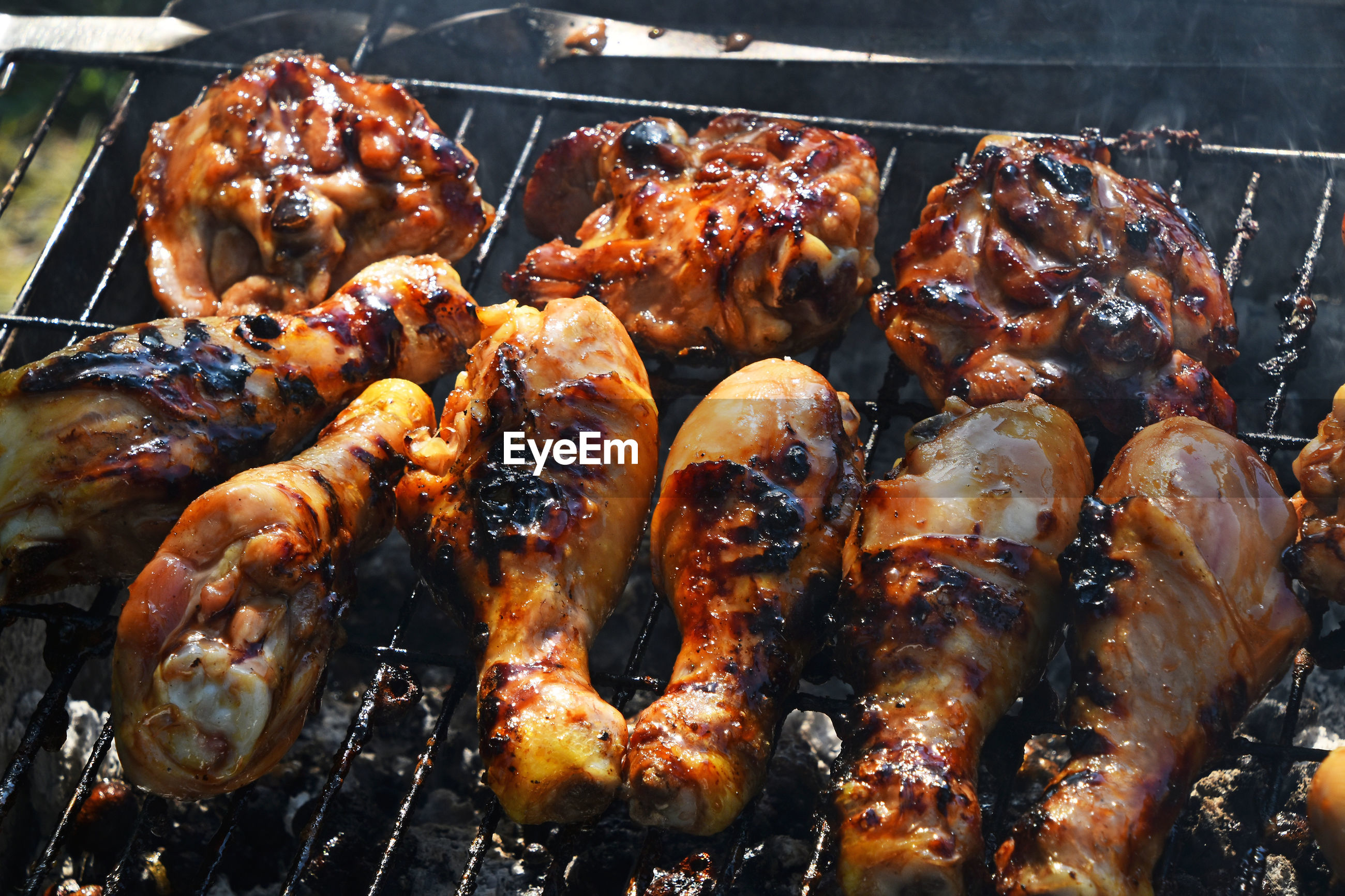 High angle view of chicken cooking on barbecue grill