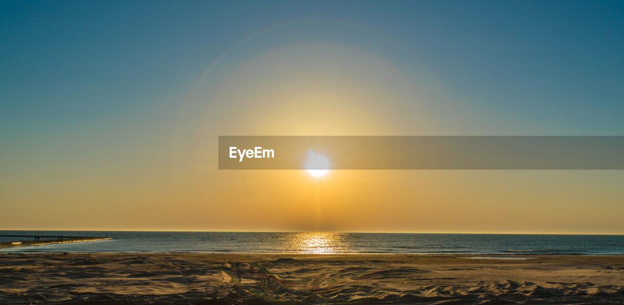sky, water, sea, scenics - nature, beauty in nature, horizon over water, horizon, sun, land, tranquility, beach, tranquil scene, sunlight, sunset, idyllic, nature, non-urban scene, no people, reflection, outdoors, lens flare, bright
