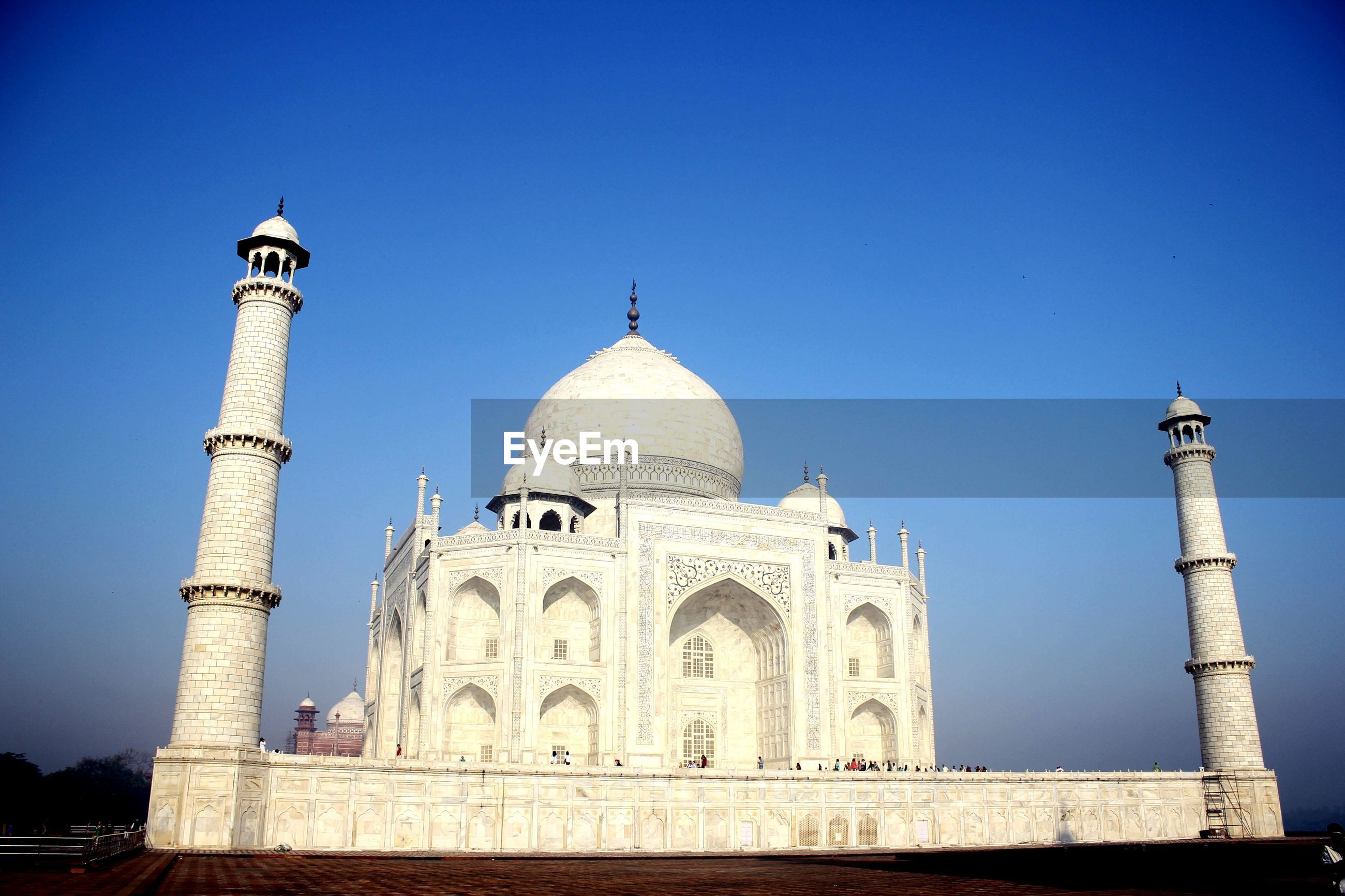 Taj mahal in city against sky