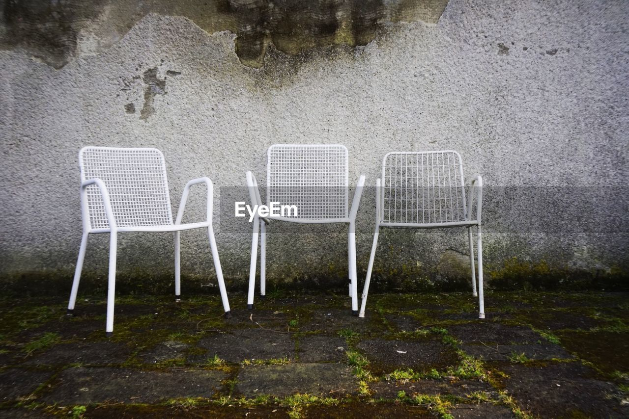 Empty chairs against the wall
