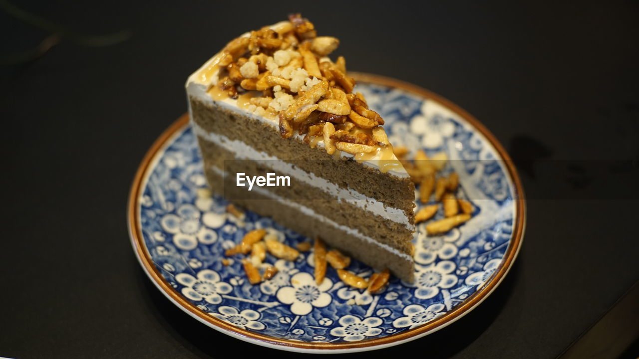 food and drink, food, indoors, sweet food, ready-to-eat, sweet, still life, plate, dessert, freshness, close-up, indulgence, baked, no people, cake, table, temptation, high angle view, focus on foreground, serving size, breakfast, black background