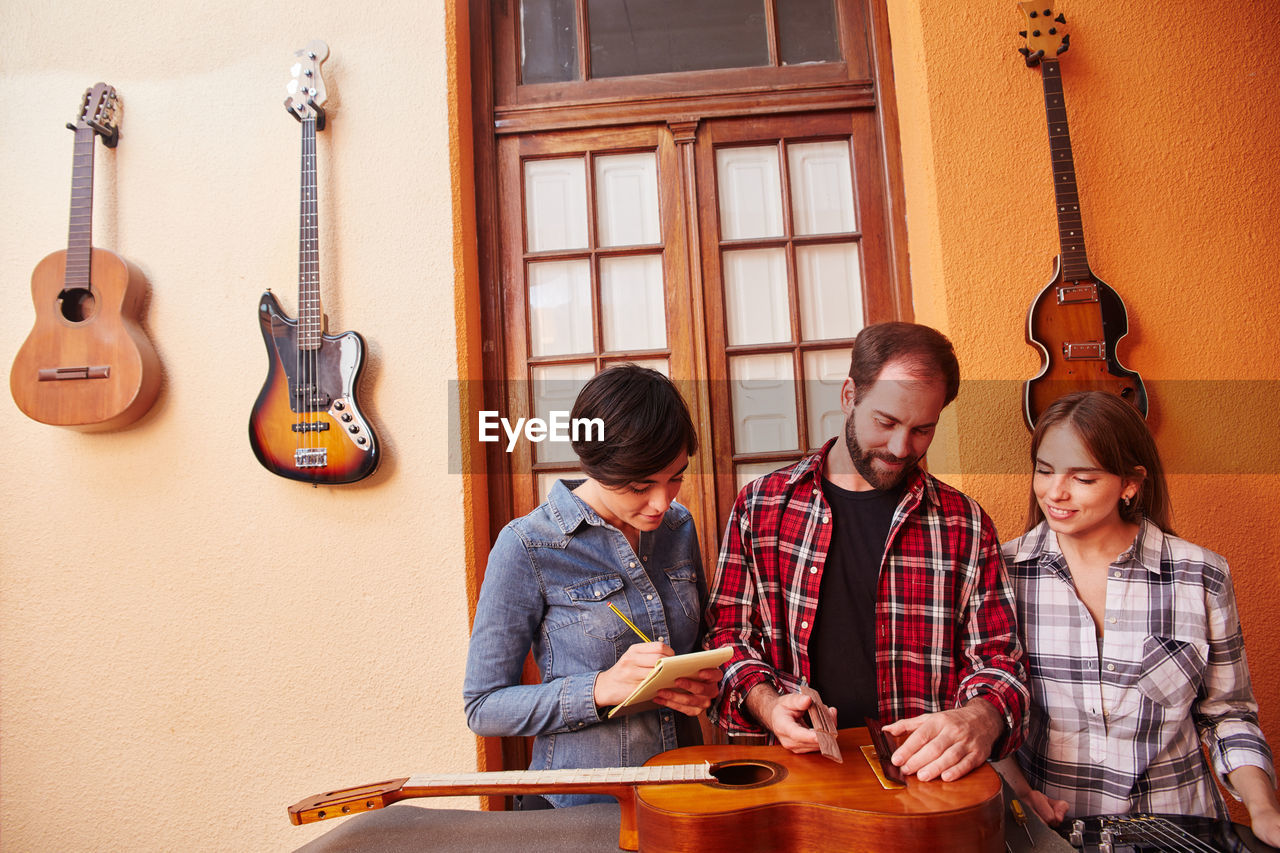 Young couple sitting on guitar