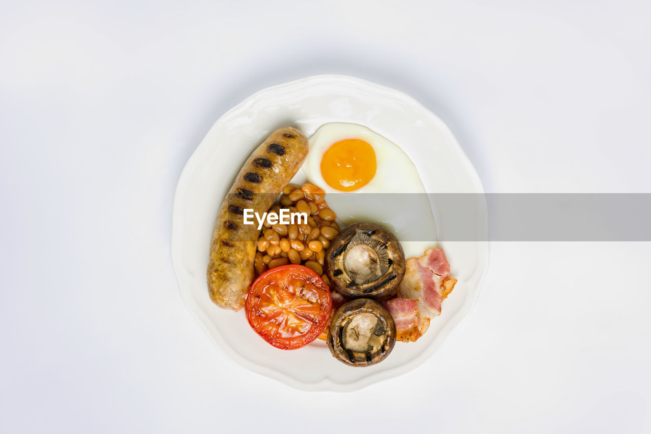 Directly above shot of breakfast served in plate over white background