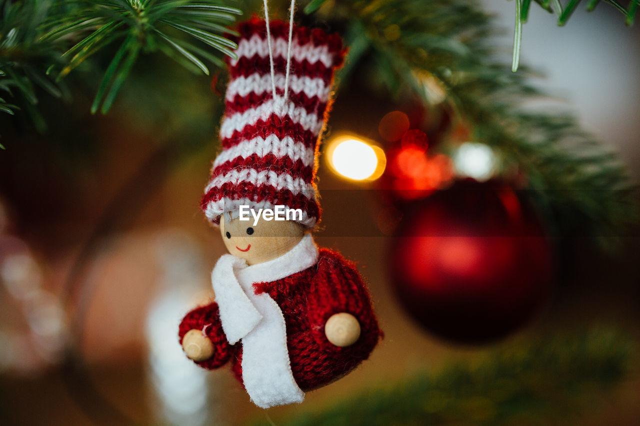 Close-Up Of Figurine Hanging On Tree