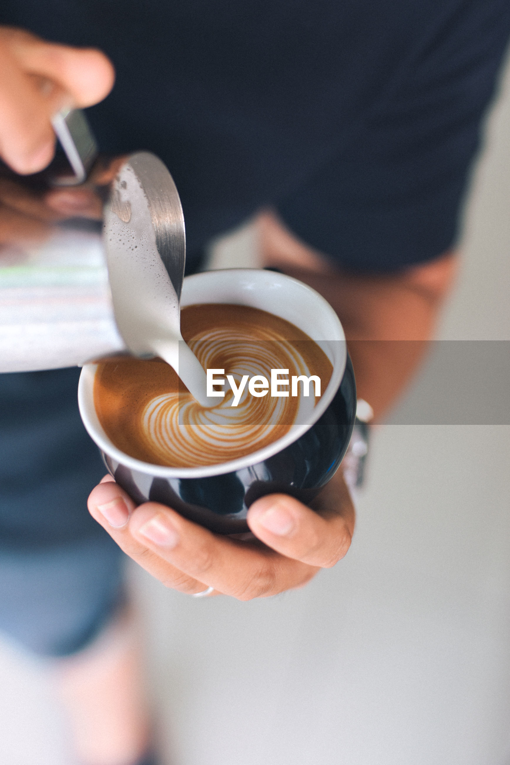 Midsection of man preparing coffee in cafe