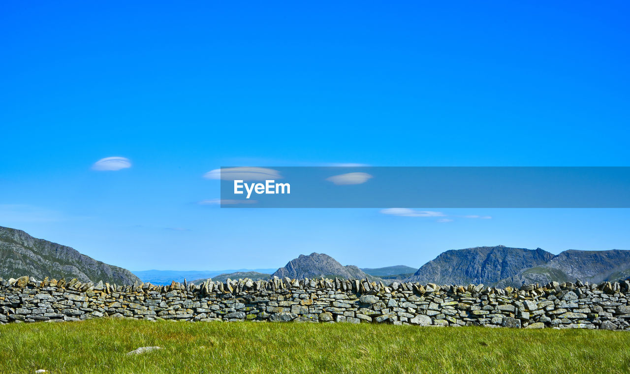 Stack Of Rocks On Mountain Against Blue Sky