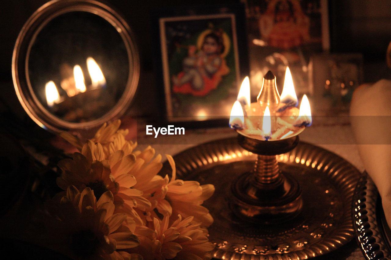 High Angle View Of Lit Diya At Temple