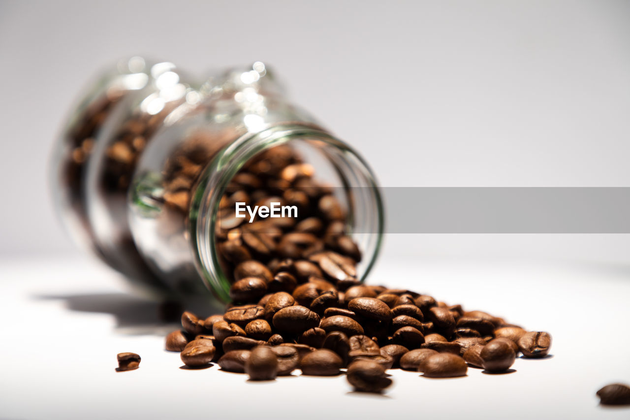 CLOSE-UP OF COFFEE BEANS IN JAR