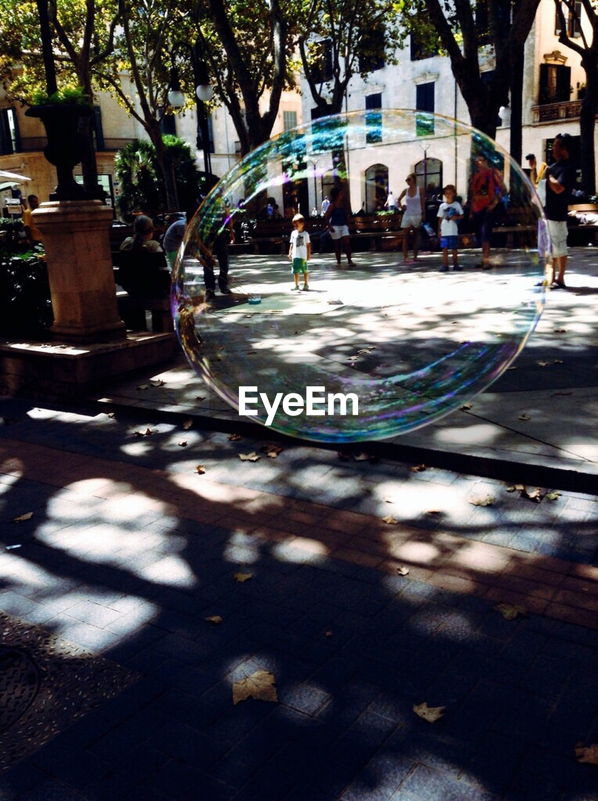 Close-up of people seen from soap bubble
