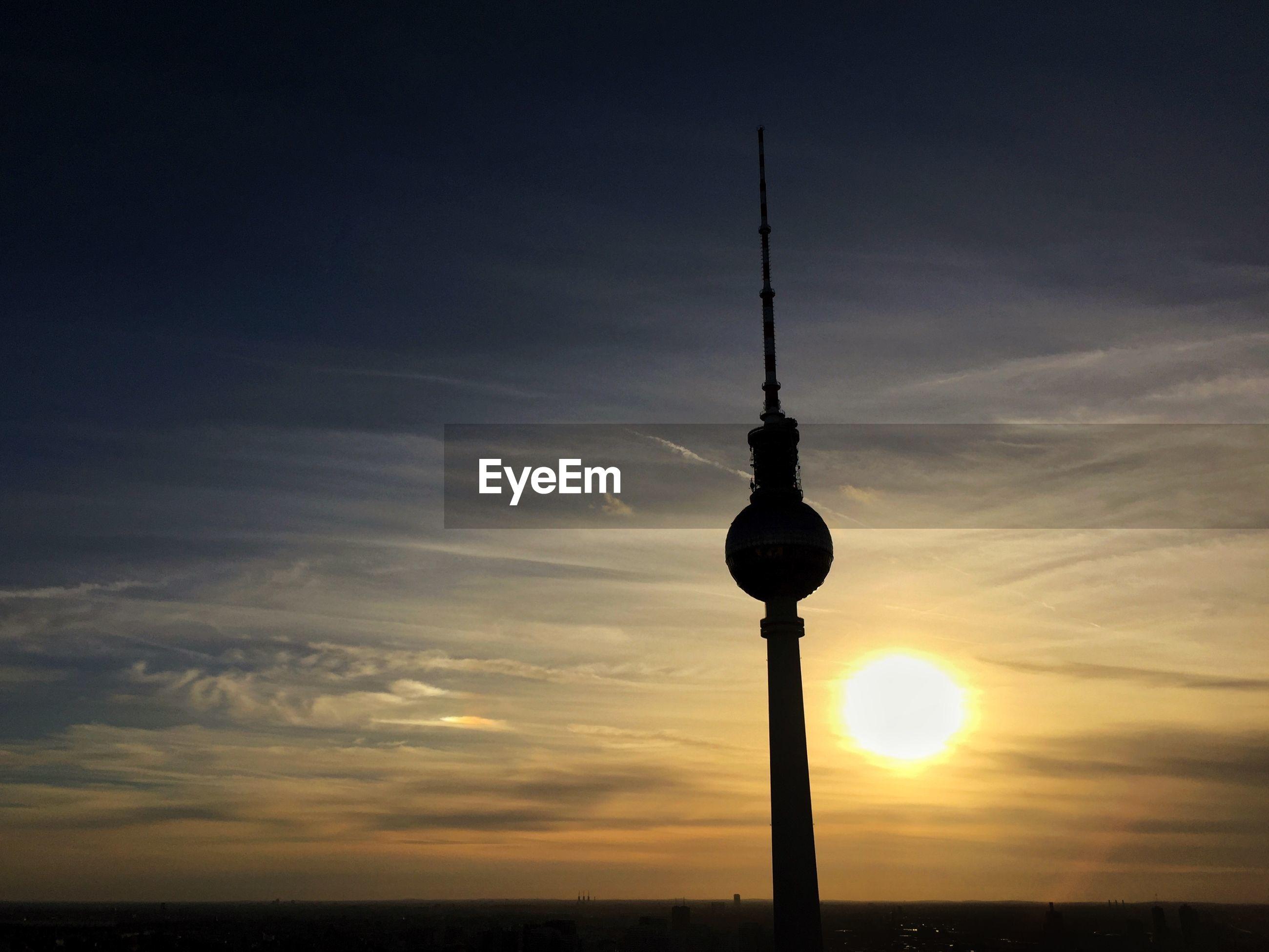 Silhouette fernsehturm against sky during sunset