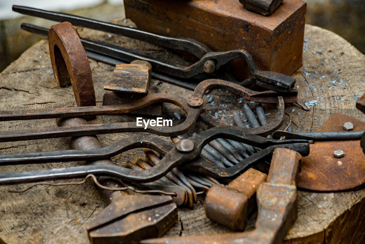 Close-up of rusty hand tools on tree stump