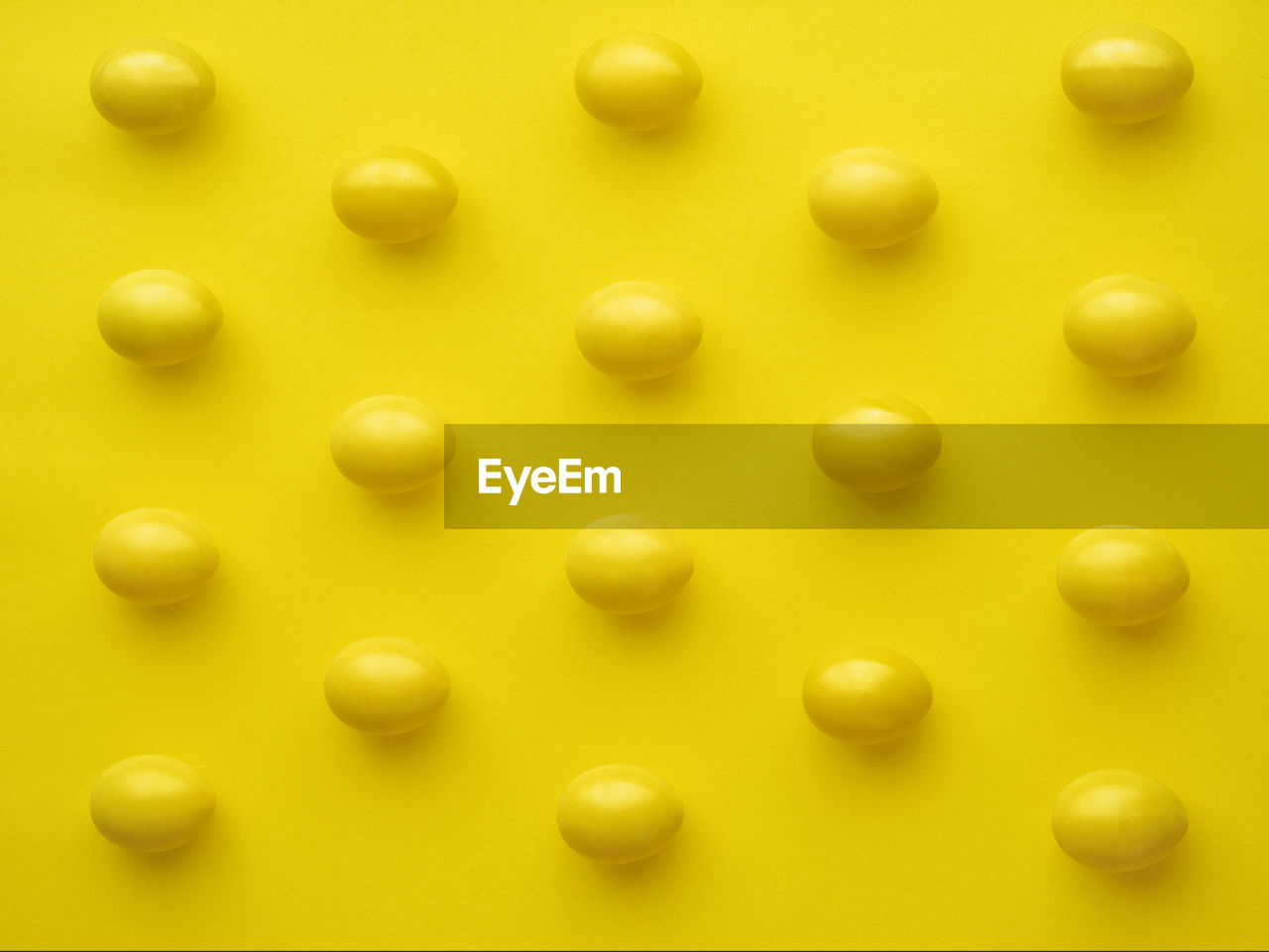 High angle view of eggs on yellow background